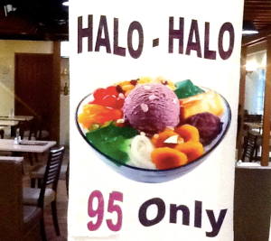 "About this photo: Halo-halo (from Tagalog word halò, ""mix"") is a popular Filipino dessert that is a mixture of shaved ice and evaporated milk to which are added various boiled sweet beans and fruits, and served in a tall glass or bowl. Ingredients include boiled kidney beans, garbanzos, sugar palm fruit (kaong), coconut sport (macapuno), and plantains caramelized in sugar, jackfruit (langkâ), gulaman, tapioca, nata de coco, sweet potato (kamote), cheese, pounded crushed young rice (pinipig). In terms of arrangement, most of the ingredients (fruits, beans, and other sweets) are first placed inside the tall glass, followed by the shaved ice. This is then sprinkled with sugar, and topped with either (or a combination of) leche flan, purple yam (ubeng pula), or ice cream. Evaporated milk is poured into the mixture upon serving. (via http://en.wikipedia.org/wiki/Halo-halo)"